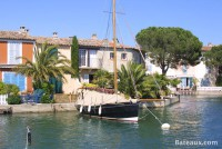 Sailboat moored in front of a house in Port Grimaud